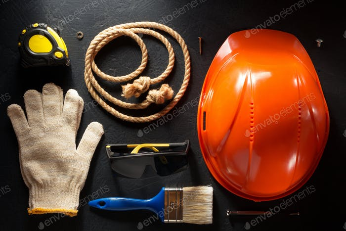 hardhat and tools  on black