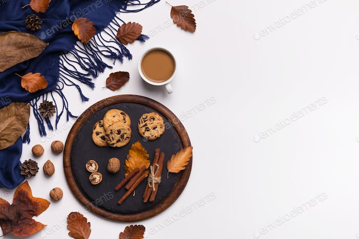 Cup of coffee, woman blue scarf and biscuits on white