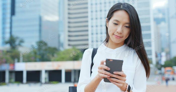 Business woman send text message on cellphone