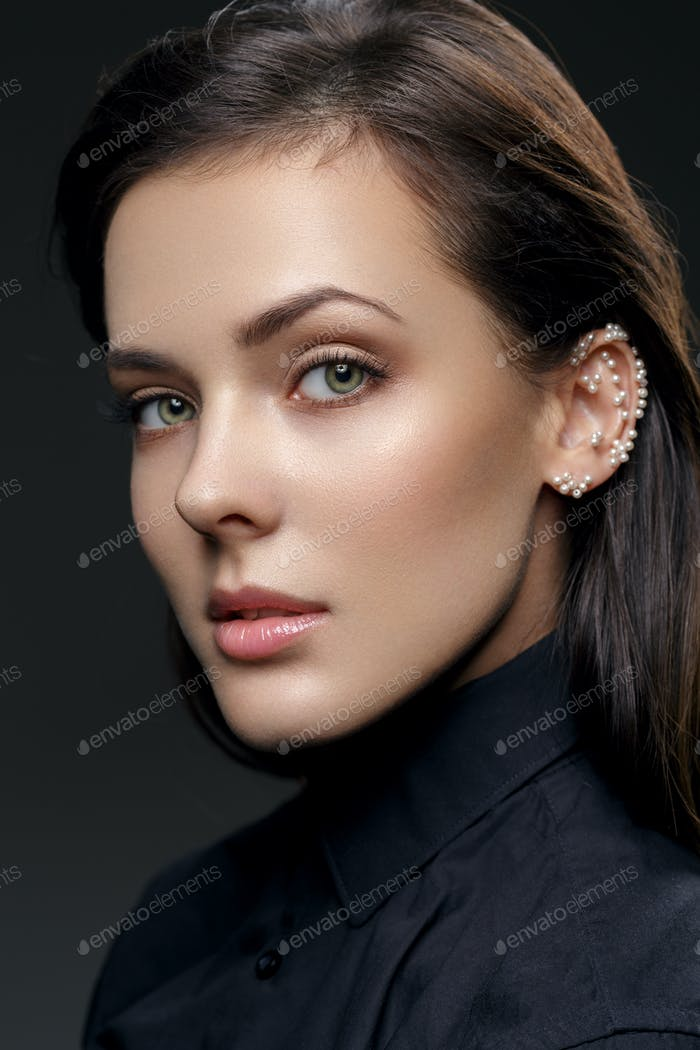 Beautiful girl with pearls on ear