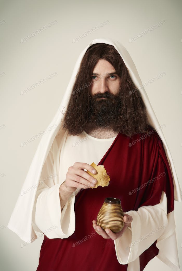 Jesus with wine jug and piece of bread