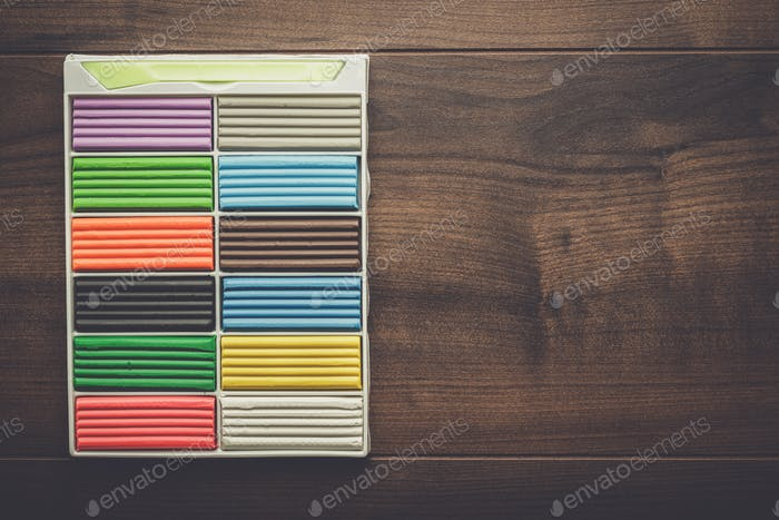 multicolored plasticine bars on the table
