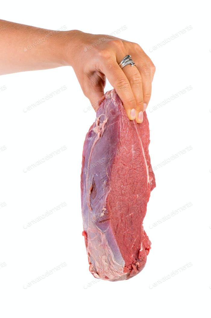 Hand hold raw veal slab
