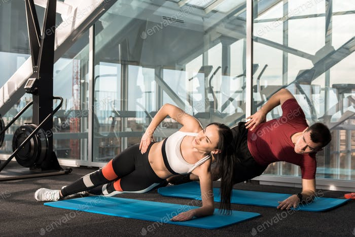 Sports Couple Working out in Gym