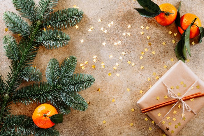 Fir branch, tangerines and Christmas gift box