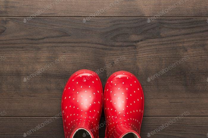 Red Gumboots On The Floor