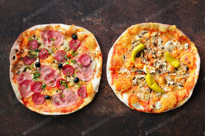 Homemade pizza. Top view with copy space on dark stone table