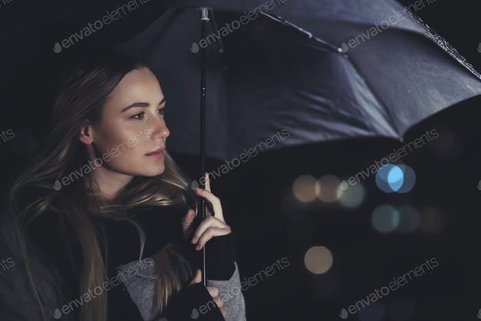 Beautiful woman under the rain