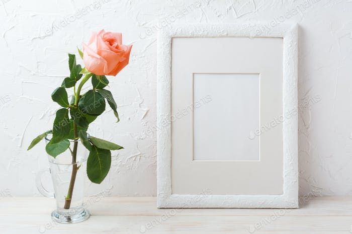 White frame mockup with creamy pink rose in glass vase
