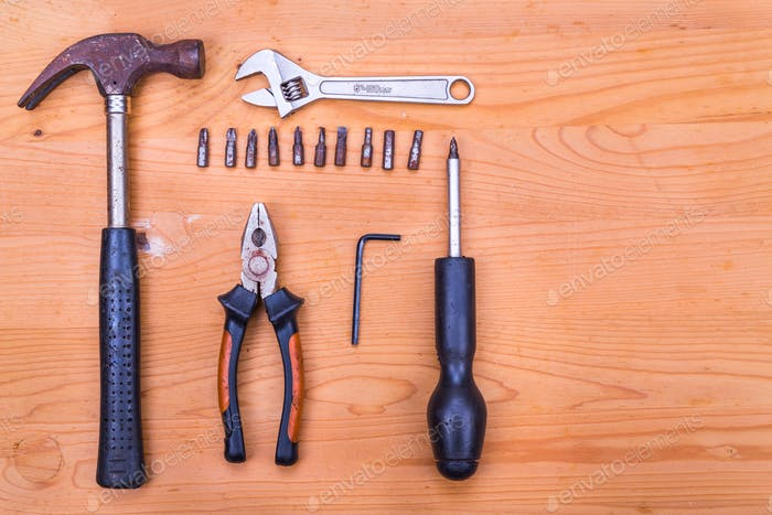 Essential basic tools set consisting hammer, plier, screwdriver,
