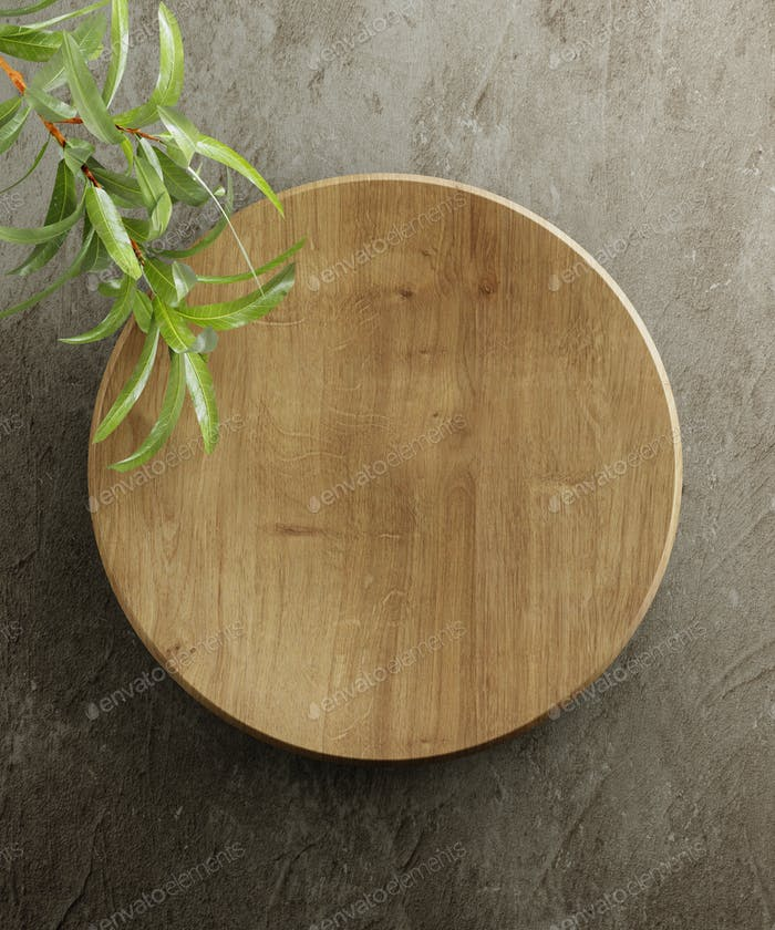 Wooden kitchen board. On a grey stone background with leaves. Top view. Free space for text