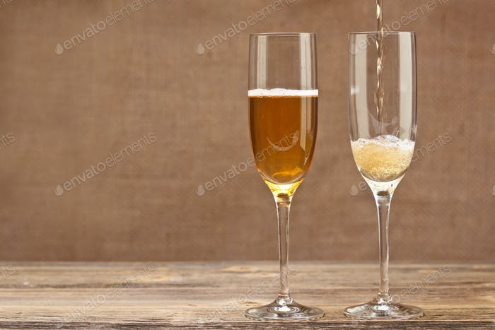 Champagne pouring in glass