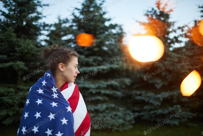 Girl walking in forest during independence day of USA