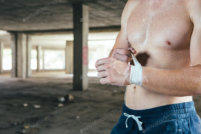 Faceless man touching elastic bandage