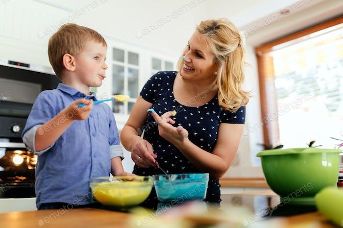 Cute child tasting cookie ingredients