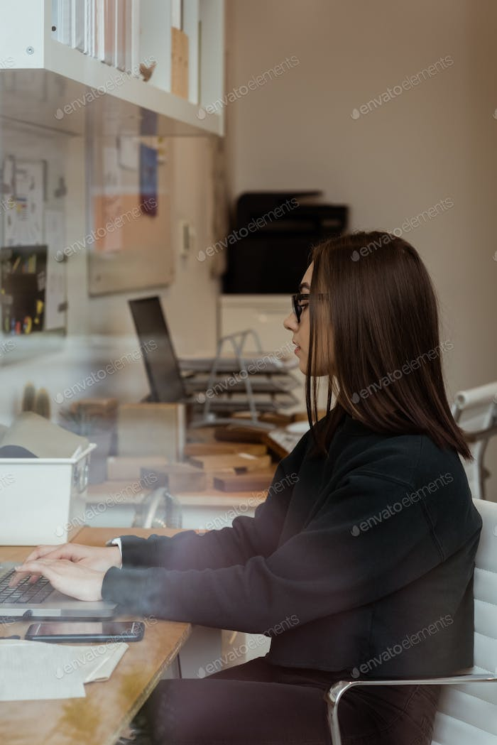 Female executive working on laptop in office