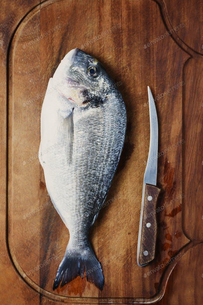 Healthy fresh raw fish on the wooden board