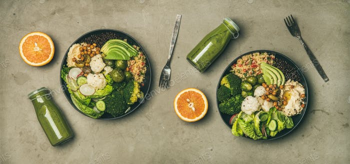 Healthy dinner with superbowls and smoothies in bottles, top view