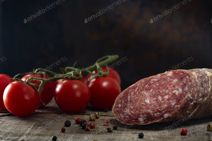 Homemade Italian salami with cherry tomatoes