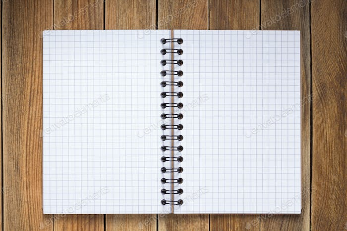 notepad or notebook paper at  wooden background