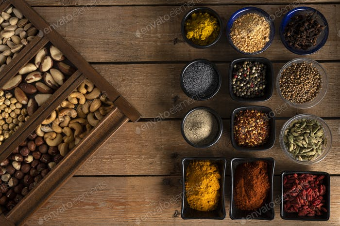 Mix of nuts and spices on a wooden table