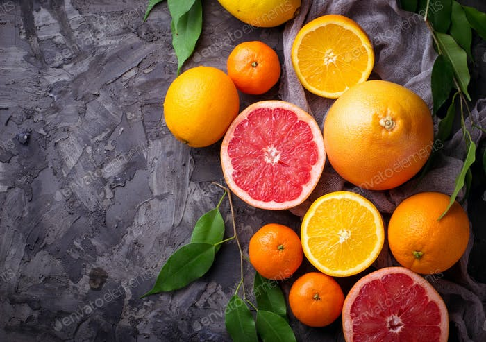 Dissected fresh fruits. Orange, grapefruit and tangerines