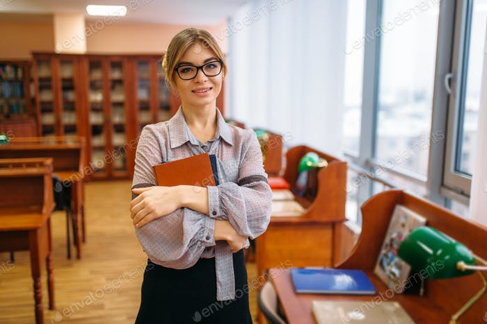 Attractive female person with books in library