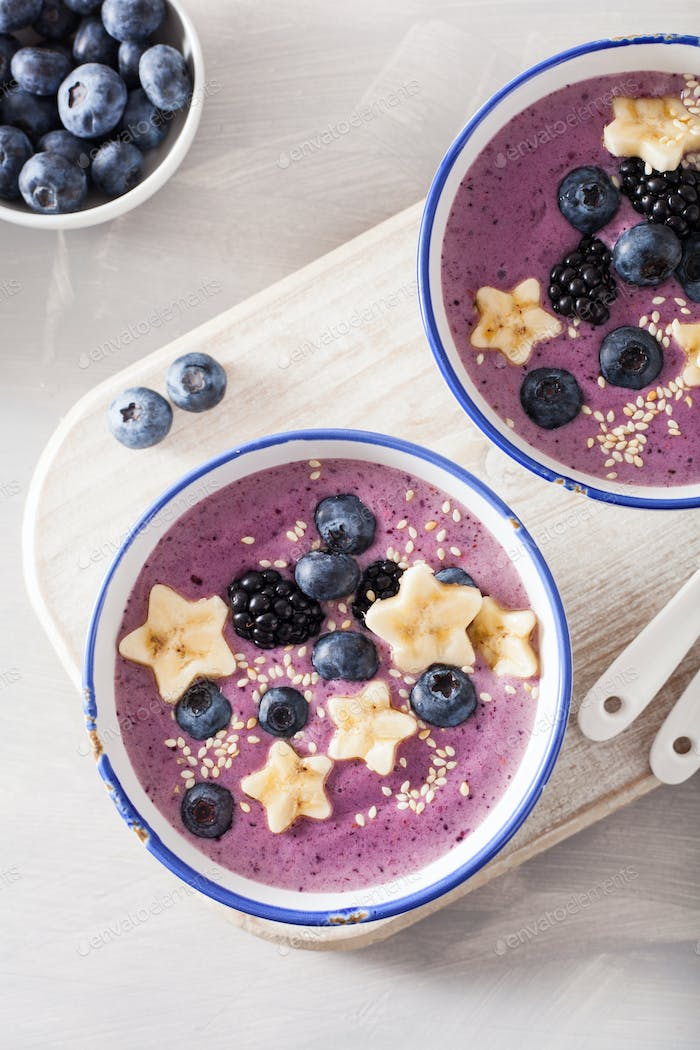 healthy berry smoothie bowl with banana and sesame seed