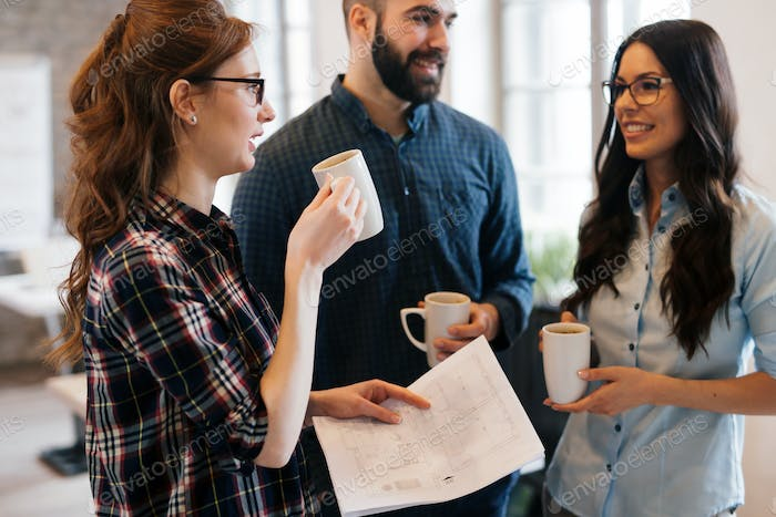 Coworking colleagues having conversation at workplace