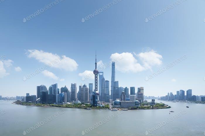 shanghai financial center against a blue sky, high angle view, like an island