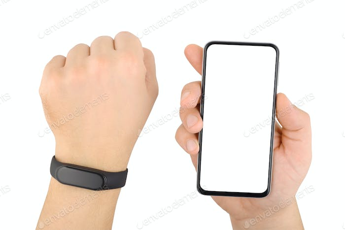 Hands with fitness tracker bracelet and smart phone isolated