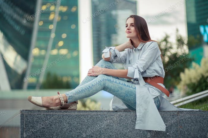 young brunette female outdoor in city