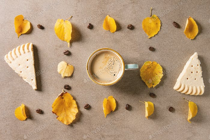 Autumn coffee with yellow leaves
