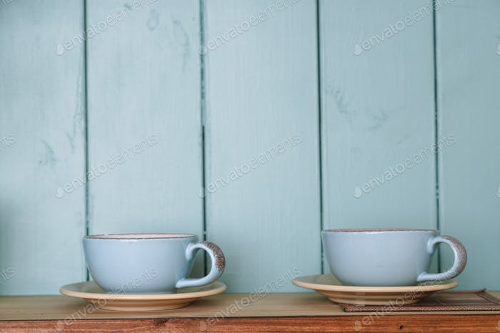 Kitchen shelf with mugs. Rustic background