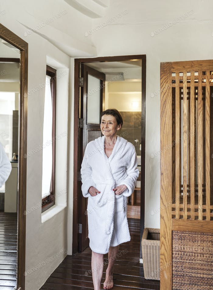Mature woman in a bathrobe at a resort