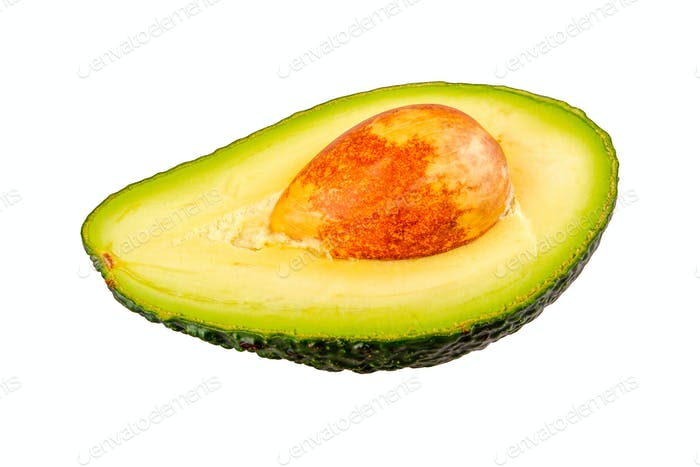 Half of cut avocado on a white background