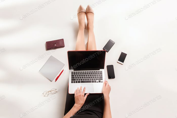 Fashion blogger writing on laptop computer