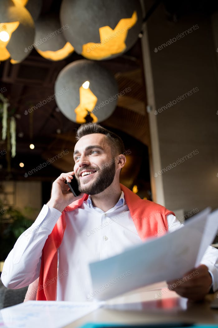 Smiling Entrepreneur Speaking by Phone