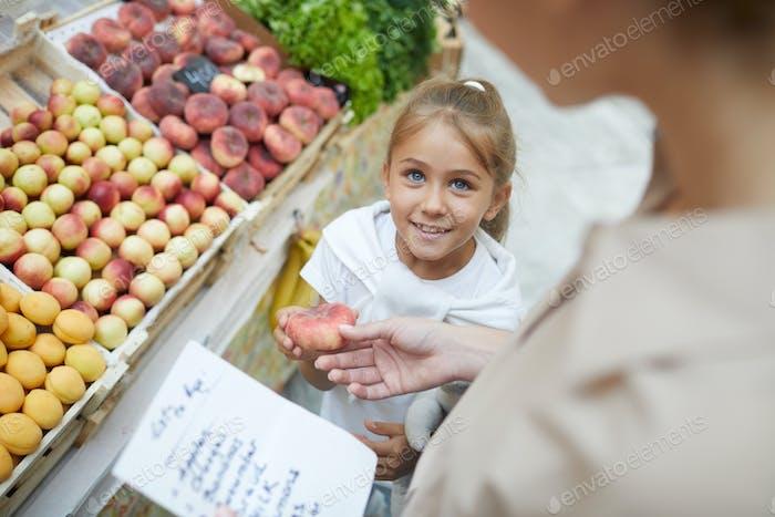Girl Choosing Fruits in Supermarket
