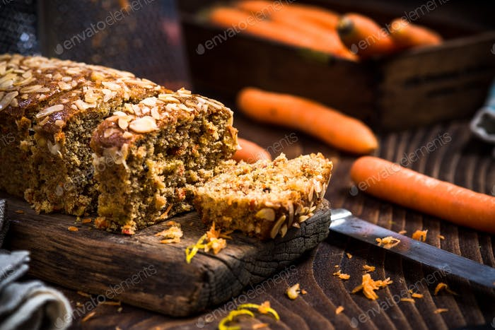 Homemade healthy carrot cake decorated with almonds and walnuts
