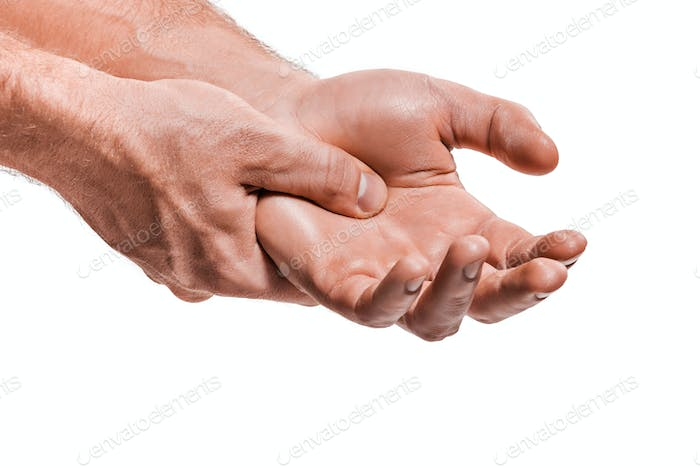 The male hands massaging