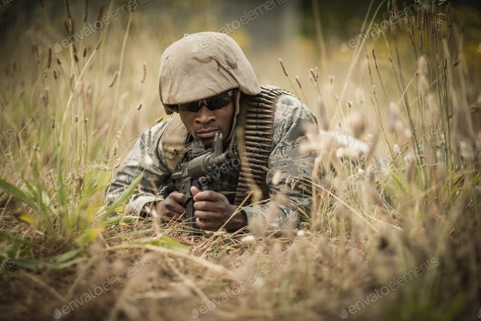Military soldier guarding with a rifle