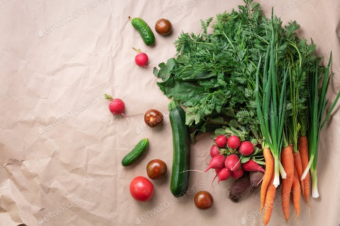 Organic vegetables over craft paper. Zero waste, plastic free concept. Healthy clean eating diet and