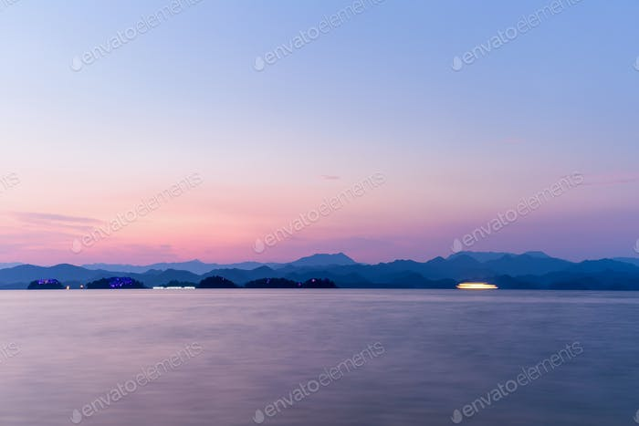 hangzhou thousand island lake in sunset