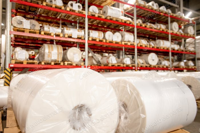 Racks of rolled and packed polyethylene film in storage area