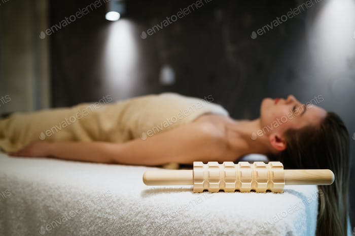 Woman relaxing in massage room