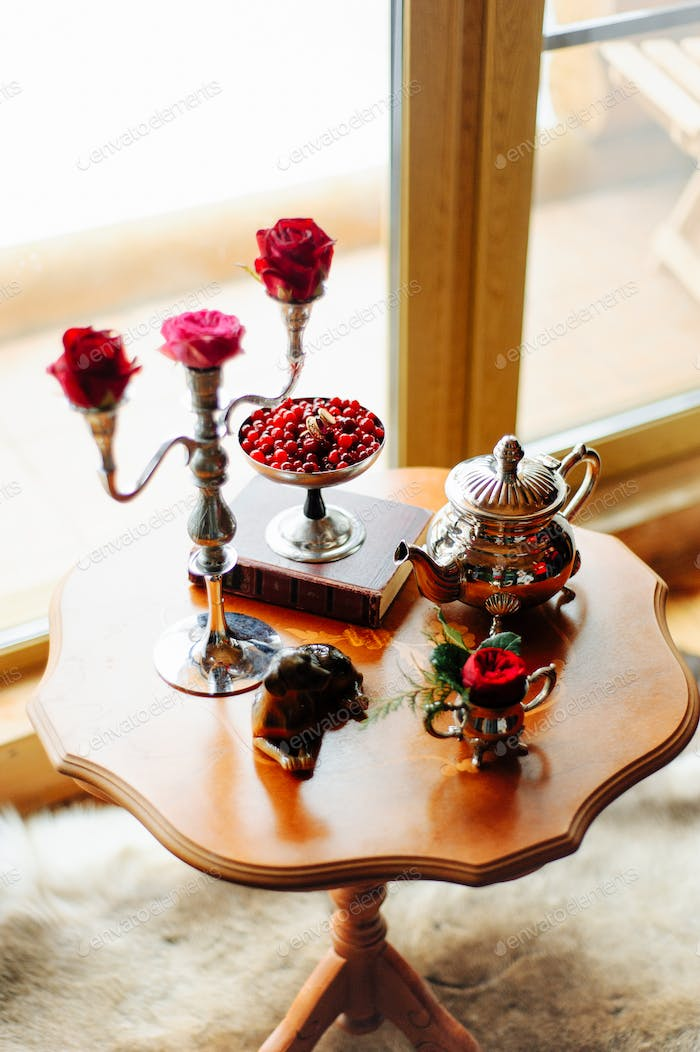 Roses on a table in candlesticks