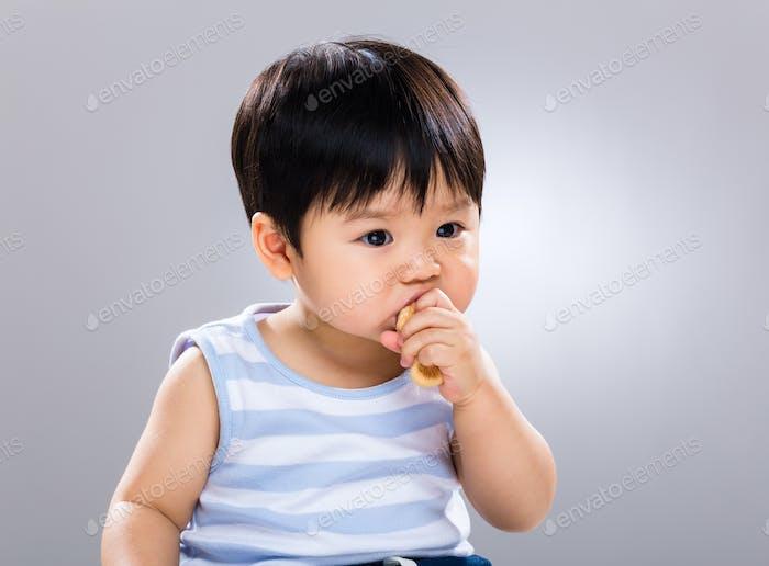 Little boy eat food