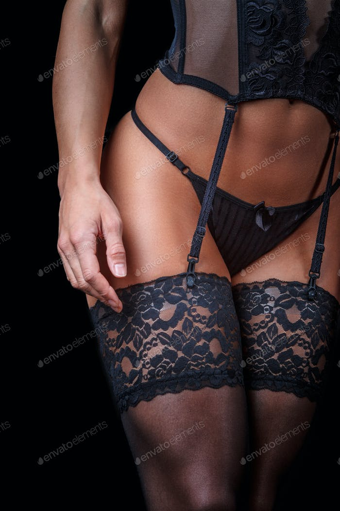 Cropped woman's body in underwear.