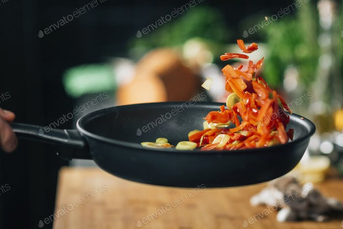 Vegetarian Restaurant Cooking - Frying Sliced Red Bell Pepper in Pan